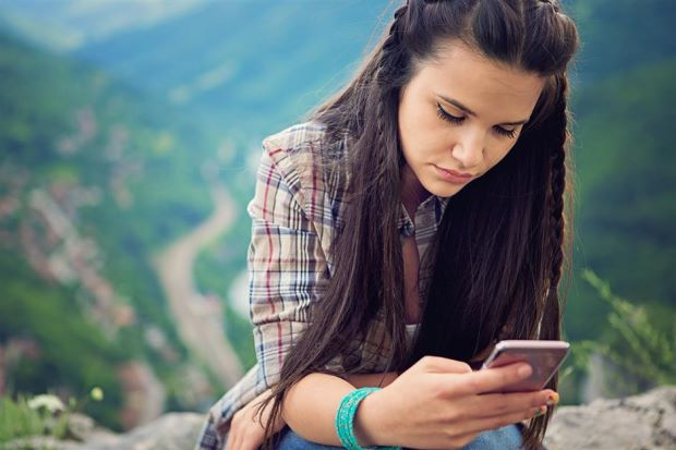 Does screen time steal happiness from teens?